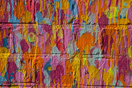 Close-up shot of vibrant multi-coloured on a brick wall in East London, England
