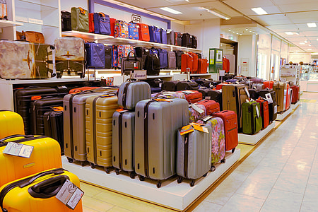 closeup photo of assorted-color luggage case lot