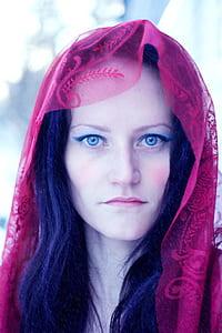 woman wearing red headdress