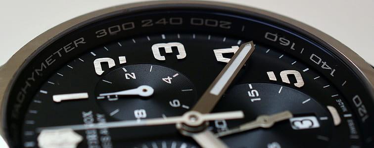 closeup photo of round black chronograph watch