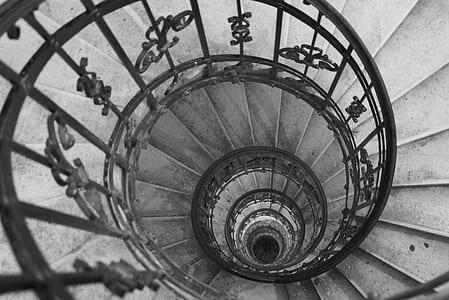 grayscale photo metal stair rail