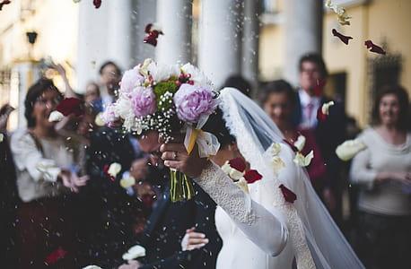 woman wearing wedding dress holding bouquet flower