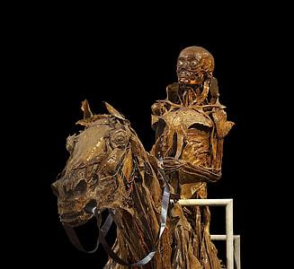 skeleton riding skeleton horse statue