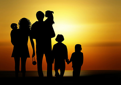silhouette photo of family during sunrise