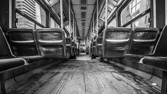 grayscale photo of seats inside train