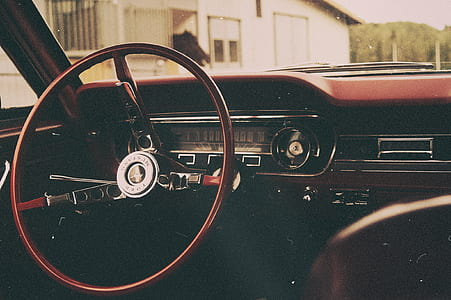 interior photo of black and brown vehicle steering wheel