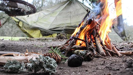 bonfire near green tent