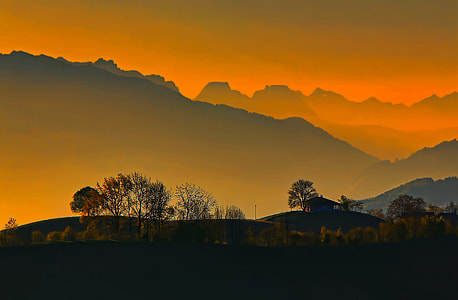silhouette of house with view of mountain