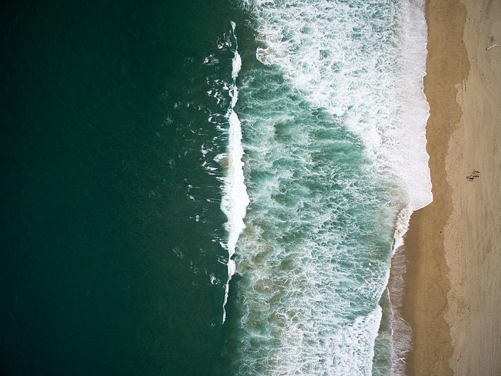 green sea water near seashore