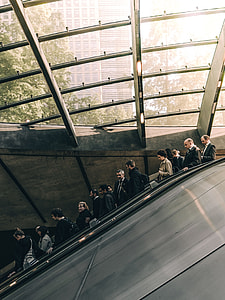 group of people on escalator