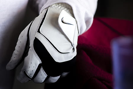 Person Wearing White And Black Nike Leather Glove