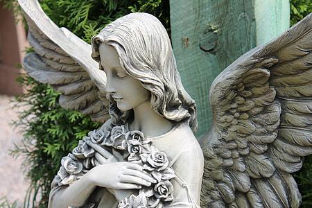 photo of guardian angel concrete sculptuyre