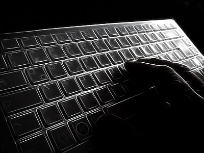 person holding computer keyboard
