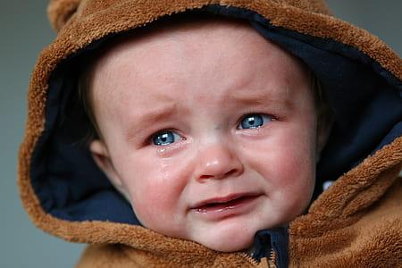 baby wearing brown suede zip-up hoodie