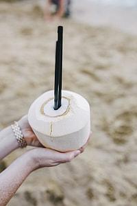 Female holding a fresh coconut
