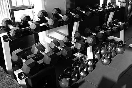 greyscale photo of gym equipment
