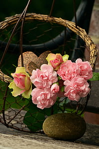 pink flowers and brown stone