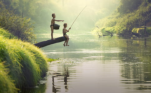 photo of two boys fishing