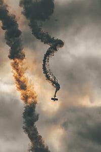 smoke emitting biplane