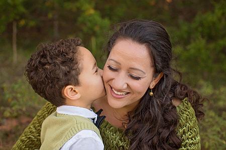 boy kissing woman in tilt photography