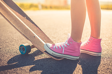 Happy Girl with Pink Shoes Ready to Longboard Ride