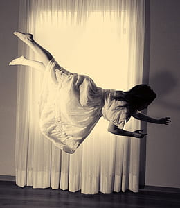 woman wearing white dress floating in the air
