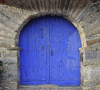photography of royal-blue wooden window