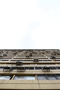 worm view photography of brown high-rise building