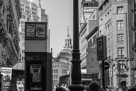 gray scale photo of telephone booth and high rise buildings