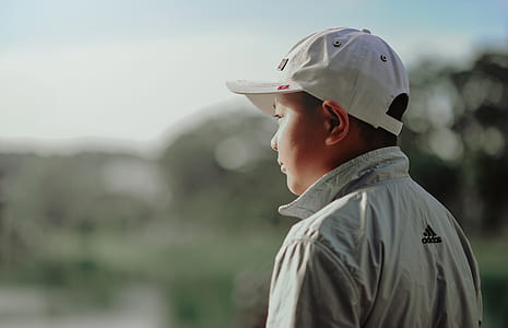 Boy Wearing Adidas Jacket and Gray Fitted Cap