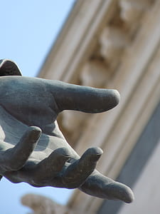 gray human hand statue