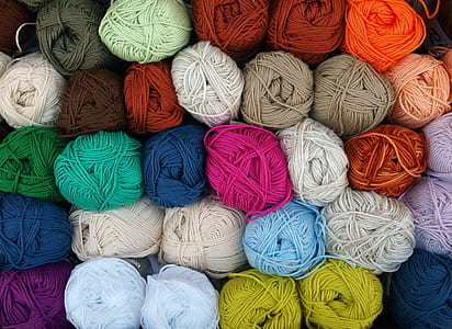 photography of piled rolled yarns