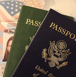 two black and green passports