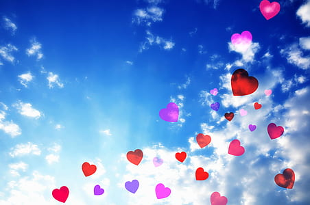 red and purple hearts illustration with white clouds background