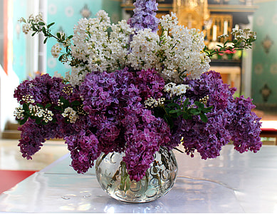 white and purple artificial flower decors