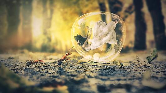 woman wearing white dress inside balloon beside ants during daytime