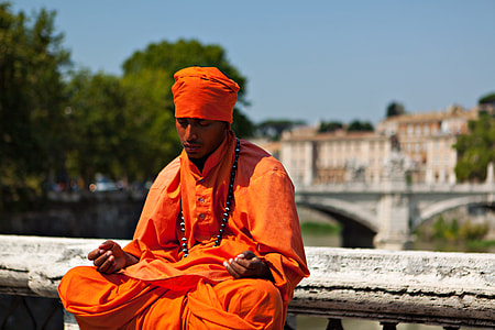 Candid shot of a man in thought and meditation. Image captured on the River Tiber in Rome, Italy