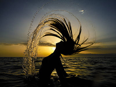 silhouette of a woman in body of water