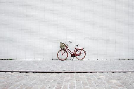 red bicycle on brick floor
