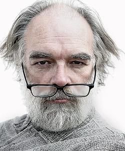man wearing black framed eyeglasses with white beard
