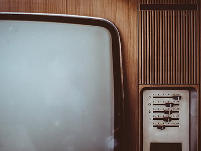 brown and grey CRT television