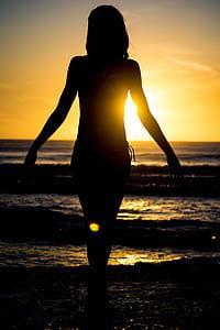 woman's silhouette in beach