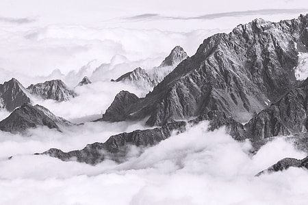 Austrian Alp mountains in the clouds