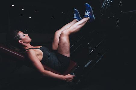 woman doing a leg press exercise