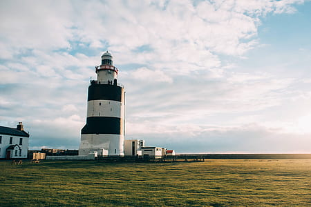 landscape photography of body of water with lighthouse