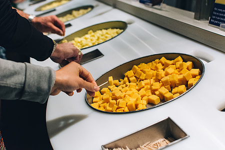 Tasting cheese in a cheese factory