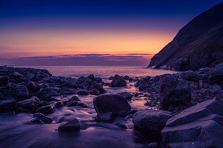 Sunset on a rocky beach in Cornwall, England
