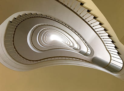worms eye view of white spiral staircase