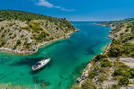 white power boat on green ocean