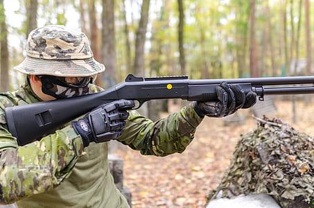 Person Holding Black Pump Shotgun